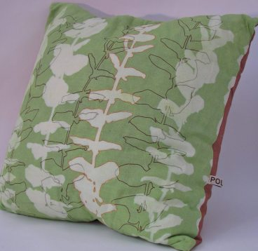 green and brown linen cushion