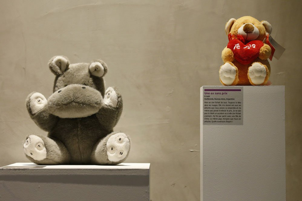 Stuffed toy animals, a hippopotamus and a bear from an ex-girl friend, are displayed at the Museum of Broken Relationships installed at the CentQuatre exhibition hall in Paris December 18, 2012. This short-lived exhibition space, in association with the museum with the same name in Zagreb, will run from December 19 to January 20, 2013 and will show relics of sentimental disappointment. REUTERS/Benoit Tessier  (FRANCE - Tags: SOCIETY)