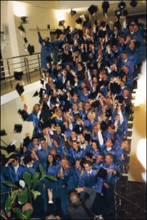 A happy post-graduation moment on the stairs in Building 'C.'