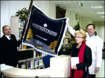WSB-NLU has its own official banner. Krzysztof Gluc and visitors from NLU found it in the new library.