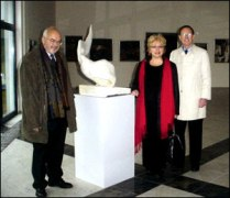 Rector Pawlowski, dean McMahon, provost Brighton, and one of the numerous art pieces in Building 'C.'