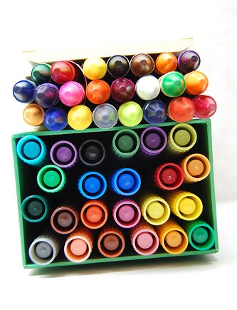 an assortment of dozens of markers in different colors all in one box