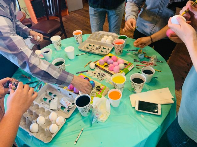 Students celebrate American Tradition by decorating Easter eggs.
