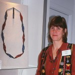 Laura Liska with her work in the MIPCES exhibition