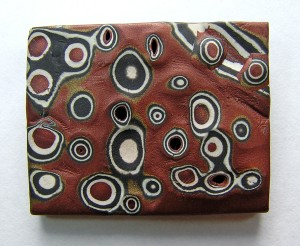 Nan Roche, polymer mokume gane sample for illustration in The New Clay, circa 1990