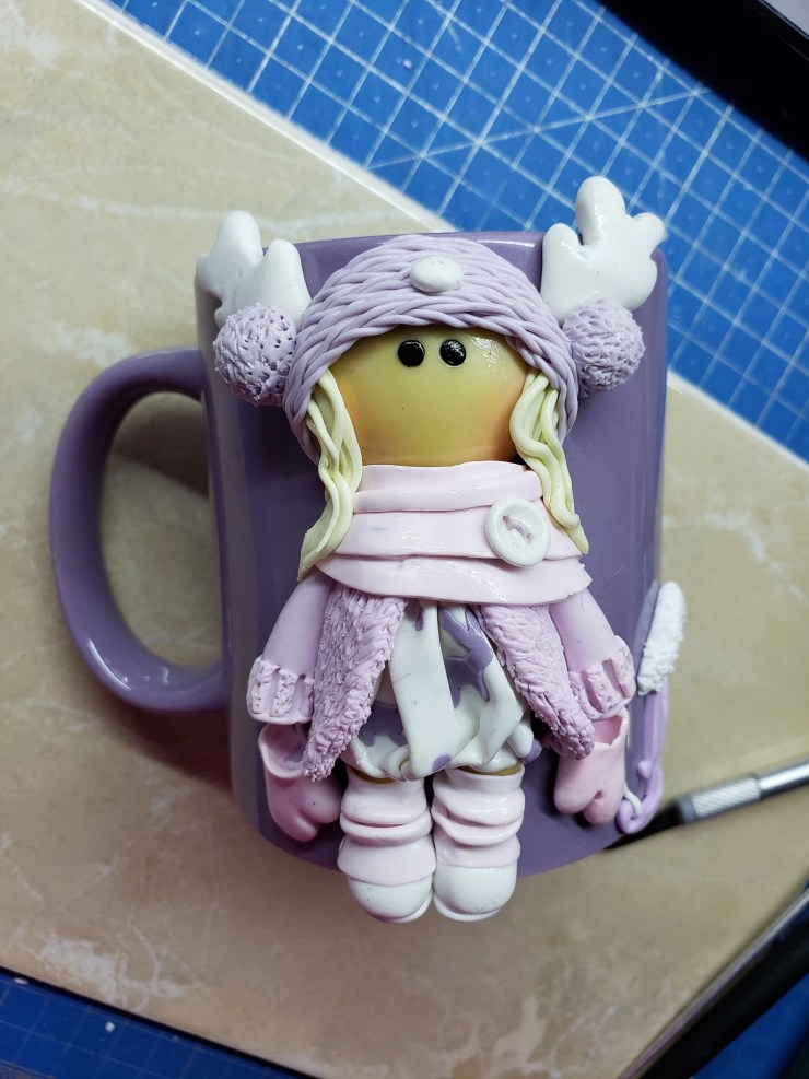 8 Polymer clay decor: Doll dressed up in winter clothes