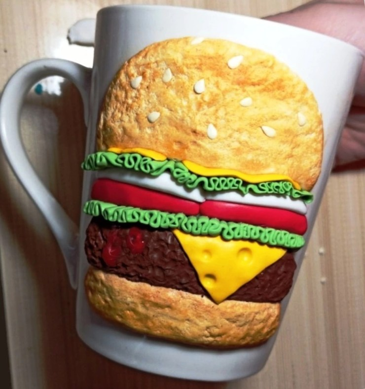 Polymer clay burger on the cup.