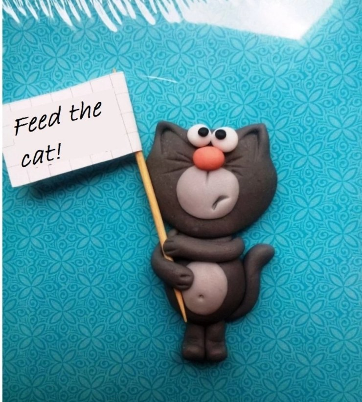 Polymer clay jewelry ideas for modeling with children: Feed the cat!