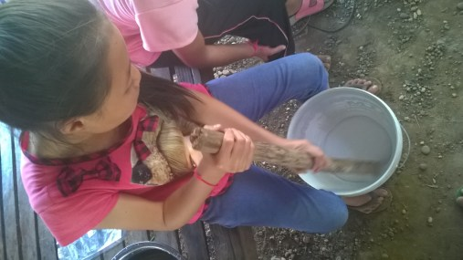 Nong patiently stired the liquid in the bucket