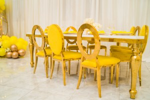 GOLD TRI TABLE & YELLOW DIOR/HOLLYWOOD CHAIR