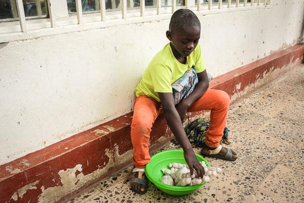 Pitshou, a chil street vendor in Lubumbashi, DRC