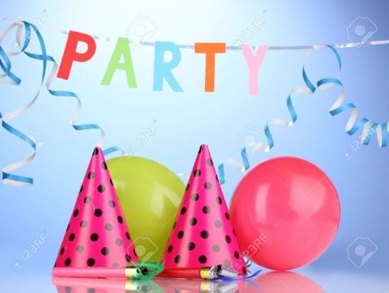 12649730-Party-items-on-blue-background-Stock-Photo-party-birthday-kids