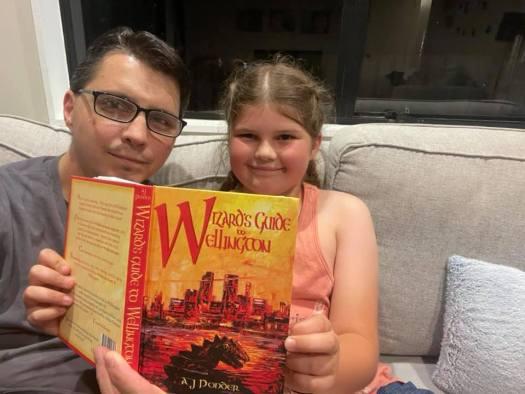 Dan Rabarts and daughter enjoying Wizard's Guide to Wellington