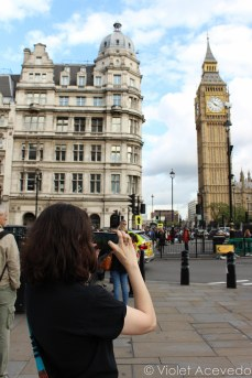 My friend taking a picture of Big Ben. © Violet Acevedo