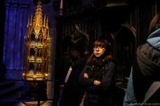 Woman looking around in Dumbledore's office. © Violet Acevedo