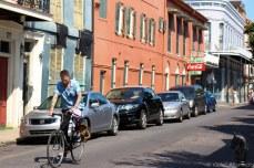 Biking along the back streets of the French Quarter. © Violet Acevedo