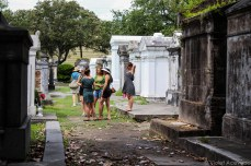 Tourists gathering amongst the tombs of Lafayette Cemetery. © Violet Acevedo