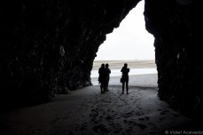 We gaze out of the caves that dot the beach. © Violet Acevedo