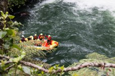Everyone had to wait until each of the four rafts came down the waterfall before moving on. © Violet Acevedo