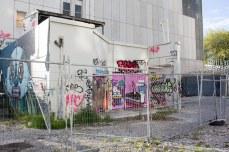 Graffiti also populates the damaged brick and concrete. © Violet Acevedo