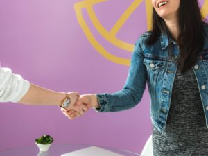 business-woman-shakes-hand_4460x4460
