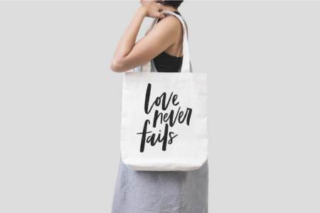 Love Never Fails Tote Bag