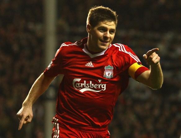 LIVERPOOL, UNITED KINGDOM - MARCH 10: Steven Gerrard of Liverpool celebrates scoring his team's third goal during the UEFA Champions League Round of Sixteen, Second Leg match between Liverpool and Real Madrid at Anfield on March 10, 2009 in Liverpool, England. (Photo by Clive Mason/Getty Images)