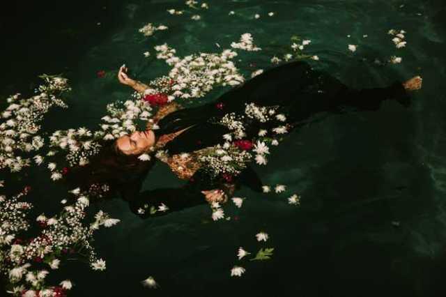 woman swimming in green swimming pool water