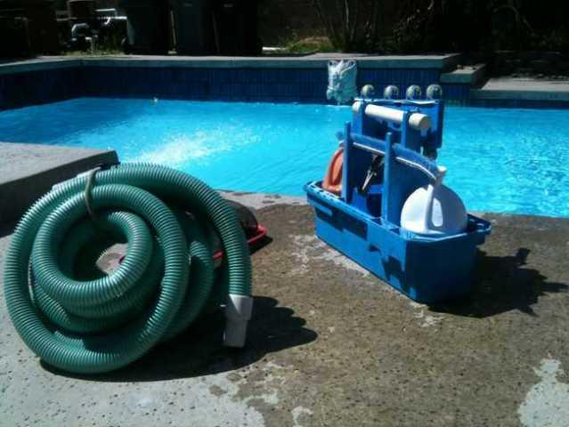 preparing to clean the pool