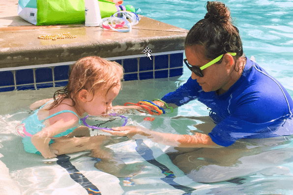 teaching toddlers to swim in your pool