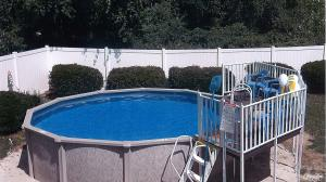Aluminum pool by Buster Crabbe Pools with fan-tail-deck