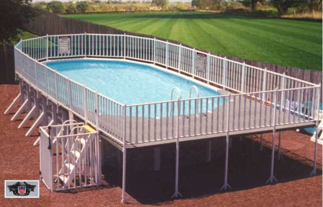 Traditional above ground pool and deck