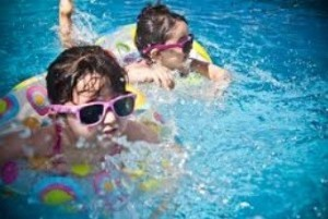 pool maintenance 101 - kids in pool
