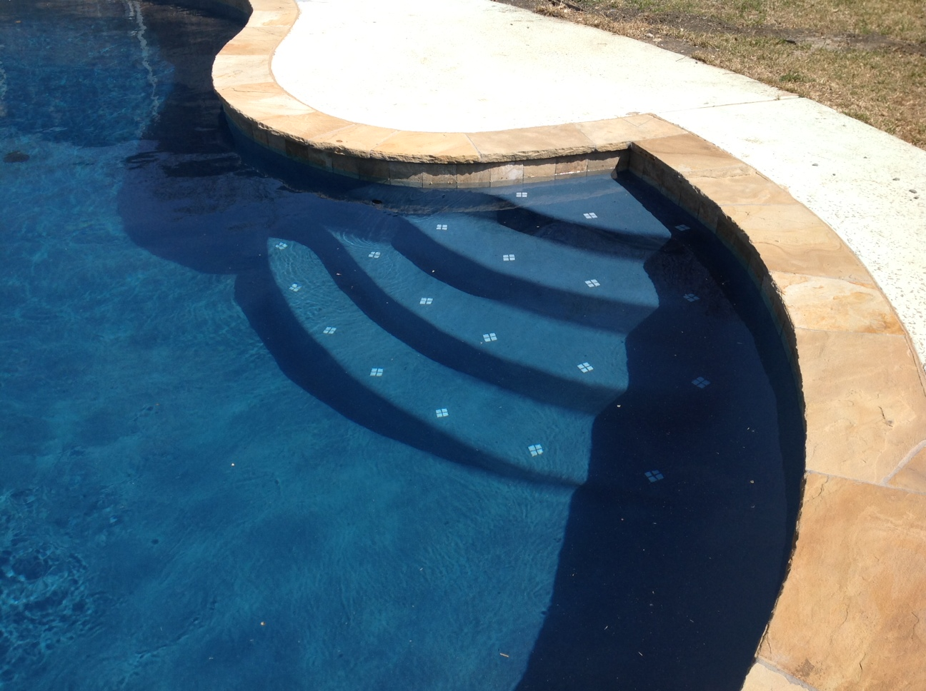 Quartzscapes regular series midnight blue quartz pool finish creates dark blue water color and is comprised of midnight blue pigmented white portland cement. Swimming Pool Finishes G B Tile And Plaster Pool Renovation Remodeling In Dallas