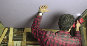 http://www.popularmechanics.com/home/interior-projects/how-to/a21610/use-this-simple-trick-to-hang-drywall-ceiling-by-yourself/