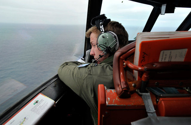 Flying Officer Benjamin Hepworth searches from a Royal Australian Airforce AP-3C Orion from Pearce Airforce Base during a search mission for possible MH370 debris on March 21, 2014 in Perth, Australia.