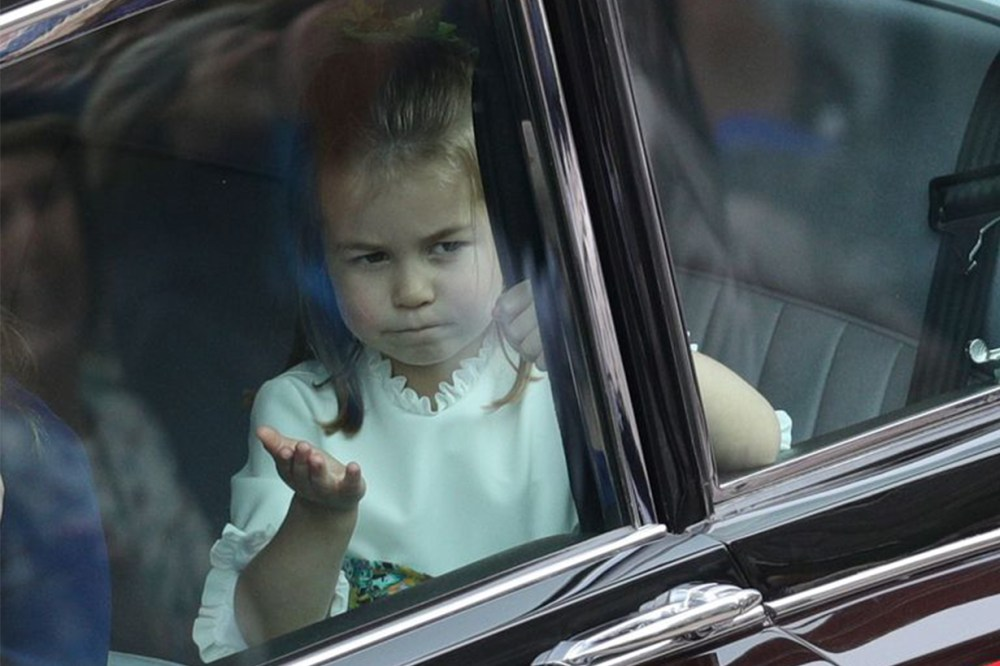 Princess Charlotte Blew a Kiss to Her Royal Fans as She Arrived at Princess Eugenie's Wedding