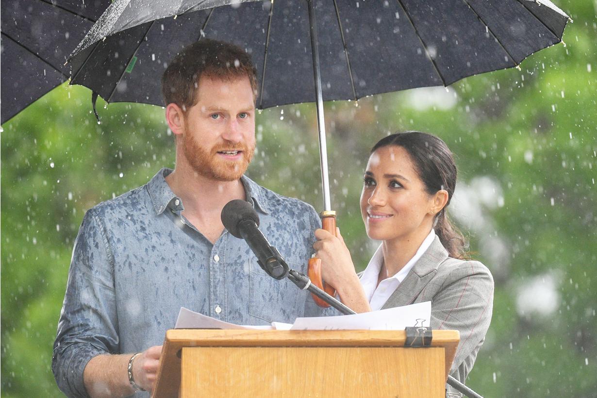Prince harry Meghan Markle australia Royal visit trip Dubbo Mayor umbrella speech in raining Swat Flies