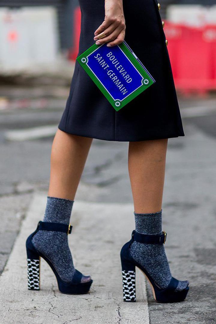 Socks styling fall winter 2018 street style street snaps fishnet socks high heels leather shoes jeans