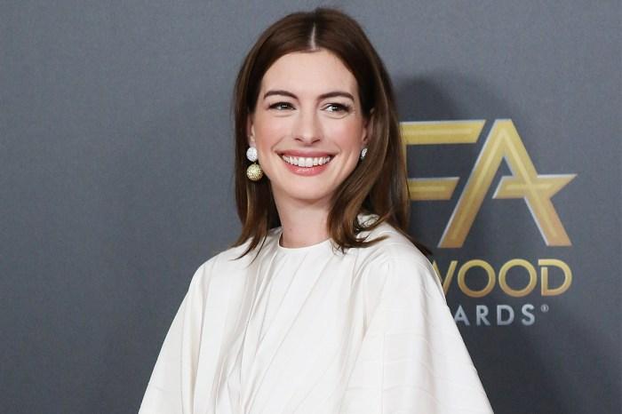 Anne Hathaway 拍劇跳唱太忘我,裙子被風吹起也繼續跳