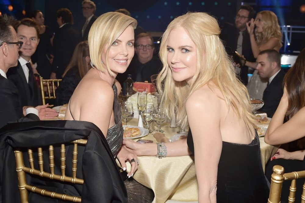 nicole kidman charlize theron critics choice red carpet keep fit