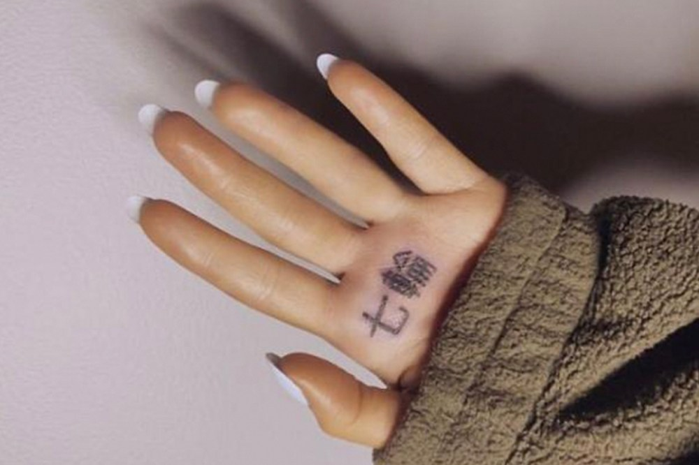 Ariana Grande 7 rings tattoo