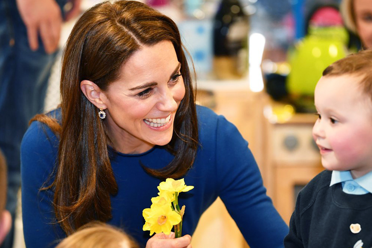 Kate Middleton Duchess of Cambridge Prince William Northern Ireland Royal Visit Malvern Primary School Cinemagic young girl braiding hair Princess Charlotte Mother of Three British Royal family