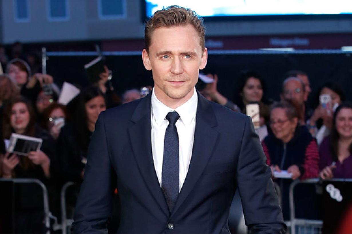 Tom Hiddleston talks to a fan in sigh language
