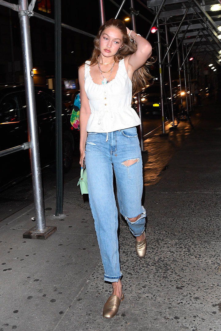 Gigi Hadid Wears White Top With Jeans and Flats