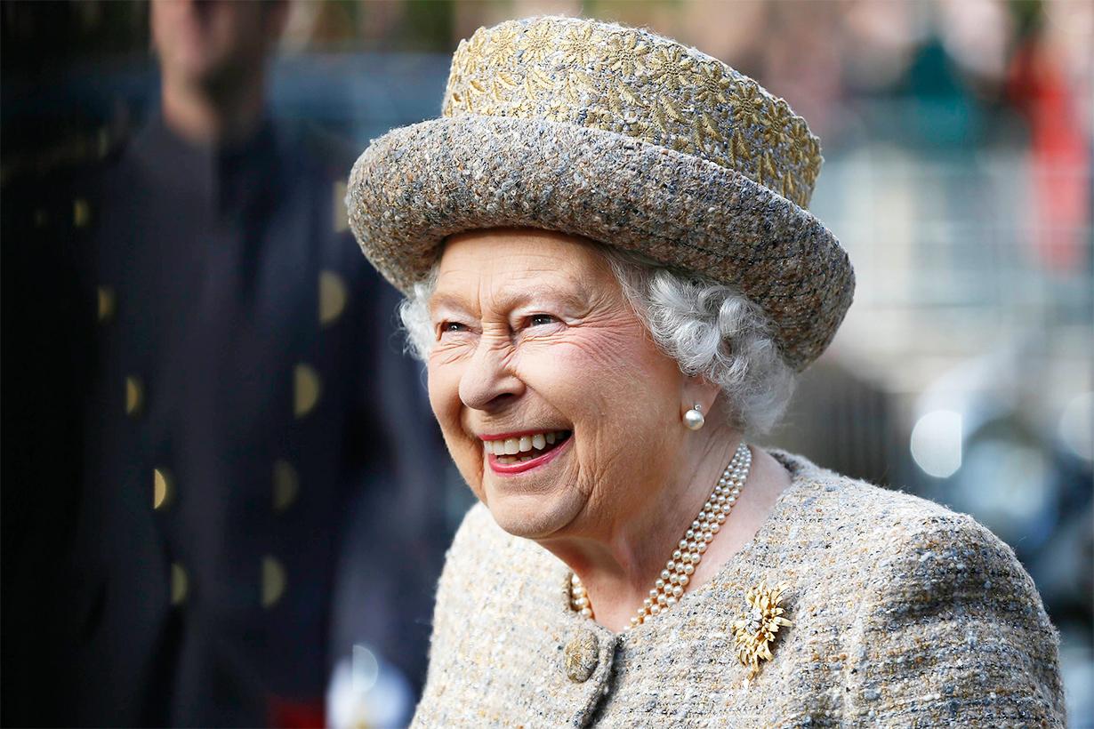 Queen Elizabeth II Balmoral castle Scotland Royal Regiment of Scotland pony mascot  bite flower British Royal Family