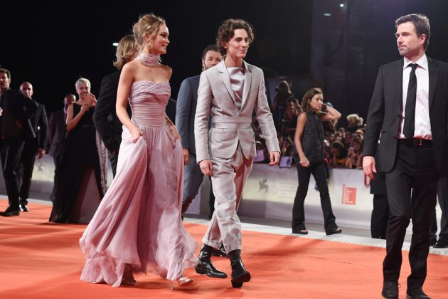 lily-rose depp timothee chalamet the king venice red carpet dress suits