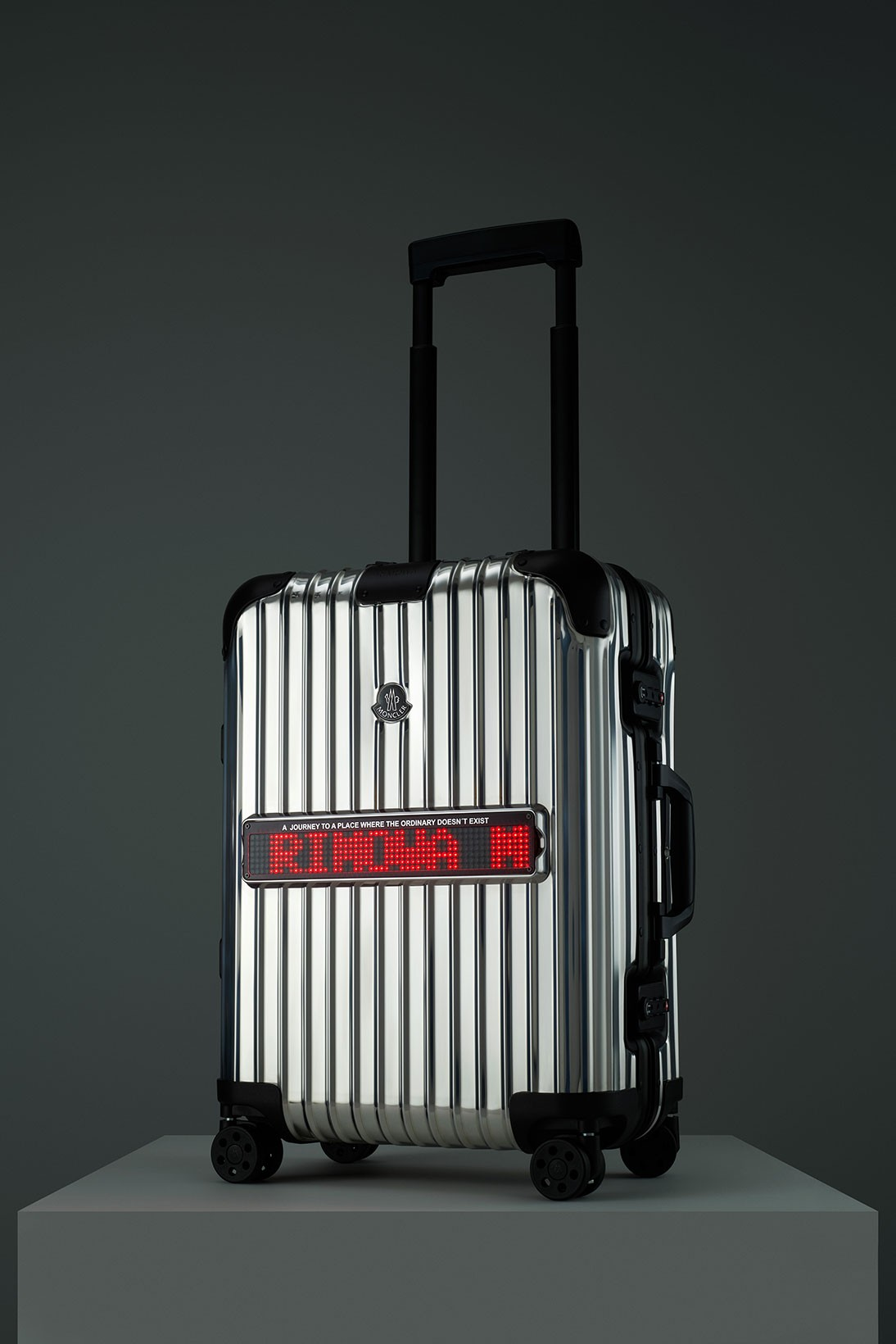 rimowa moncler genius reflection collaboration suitcase luggage