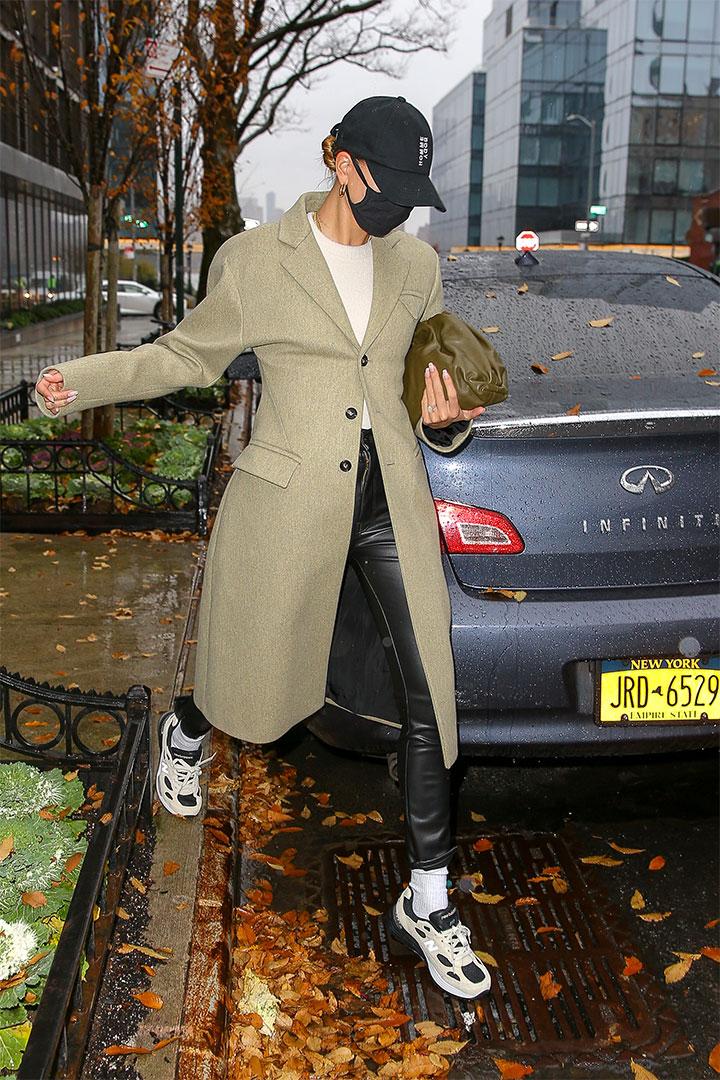 Hailey Bieber Wears Bottega Veneta Overcoat and Leather Pants