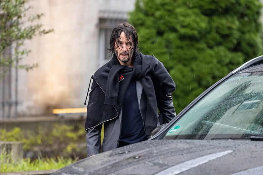 Keanu Reeves sports wet hair exiting hotel Berlin John Wick 4